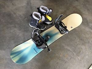 3 snowboards and boots