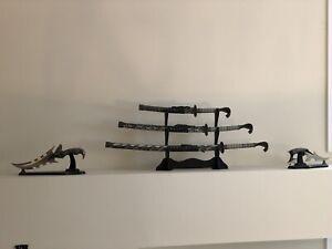 Beautiful antique samurai swords and two miniature ones