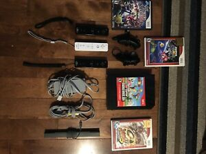Nintendo Wii with 4 games, 3 controllers and 2 nunchucks