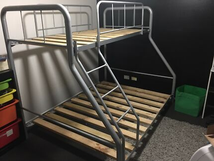 Double and single bunk beds and corner desk