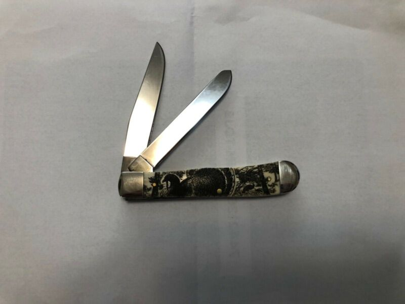 Case trapper knife with turkey on handle