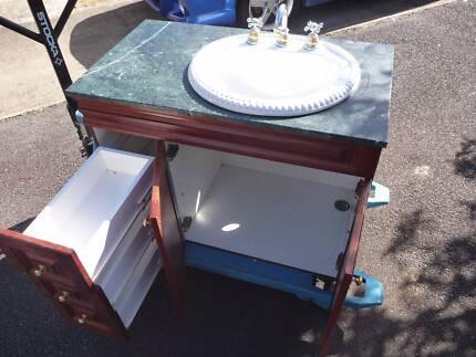Marble bathroom vanity with ceramic sink, taps, fixtures mahogany