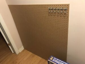 Two peg boards and brand new storage system bins