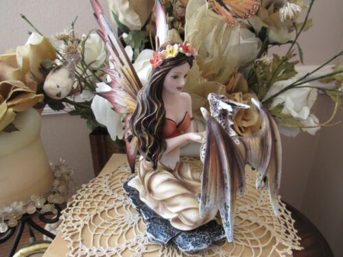 Blue-eyed Fall Colors Fairy Figurine with baby dragon by Pacific Giftware New