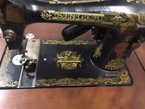 Old antique singer sewing machine with table