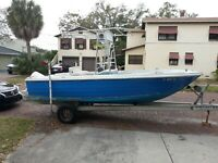 boat and motor. Classic bayliner with 112 hp johnson outboard