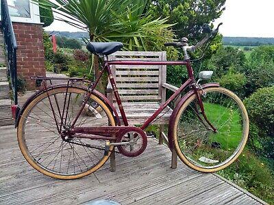 Vintage Raleigh 3-speed steel road bike, light.