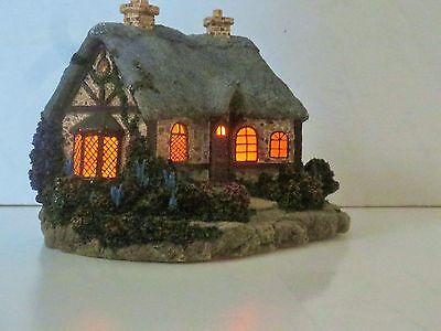 Thomas Kinkade Cottage Village Collection Windows light up dual chimneys
