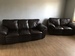 Leather couch and love seat. 200$ takes it!