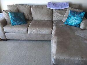 Sectional couch with queen sized pull out, amazing condition