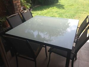 Glass top outdoor table- good condition Varsity Lakes Gold Coast South Preview