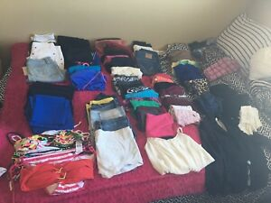 Huge bag of brand name women's clothes! Some with tags