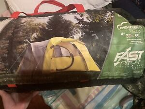 8 person camping tent and small propane tanks for camping