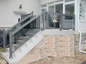 Aluminum railing with glass column gate. HomeStars approved