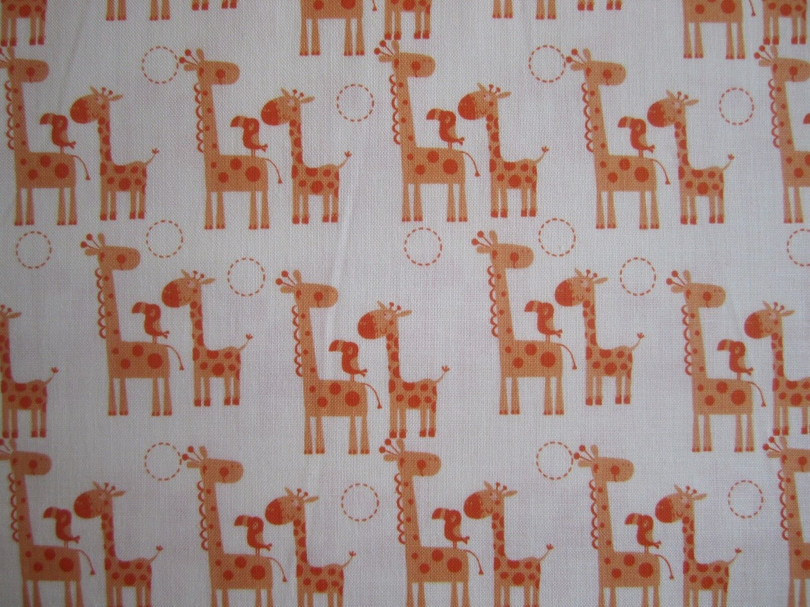 Orange Giraffes - 100% cotton fabric from 'Giraffe Crossing' by Riley Blake