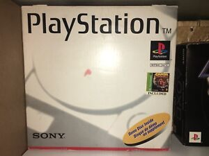 Ps1 in box with bunch of games