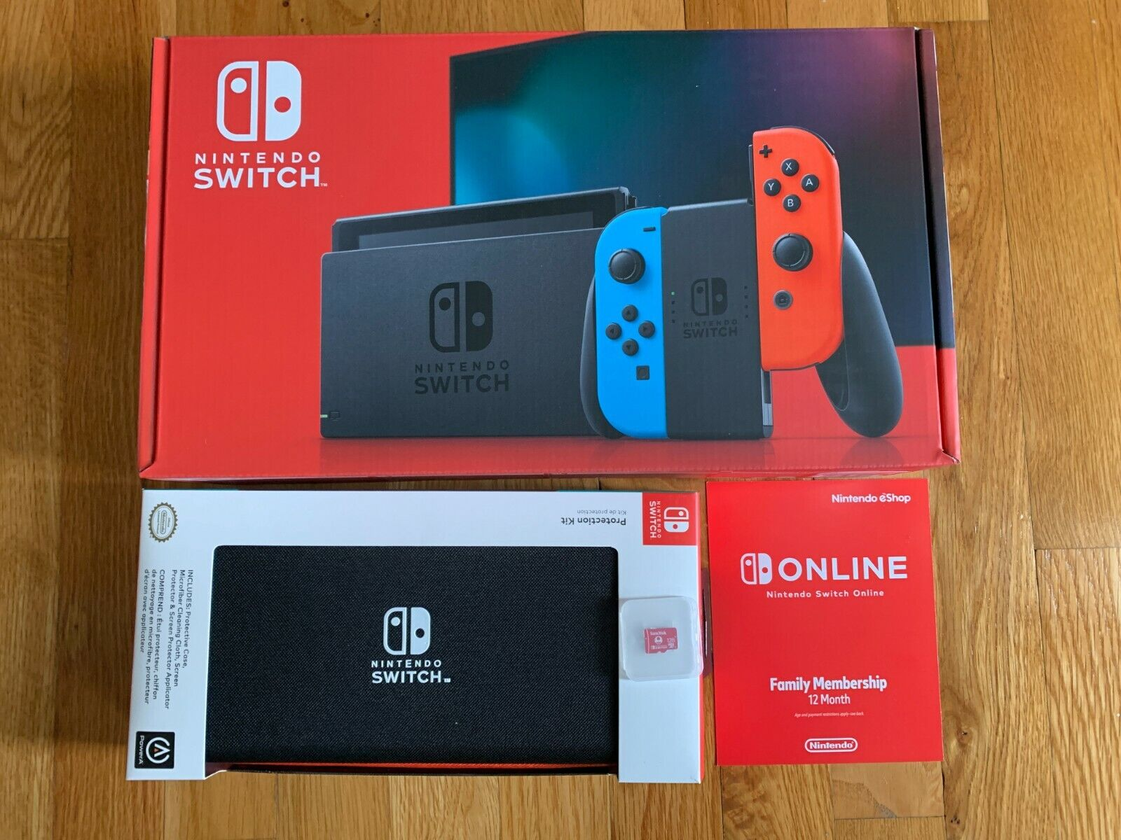 New Version Nintendo Switch 32 GB Console - Blue/Red bundle : case + sd + plan