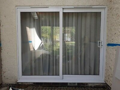 used white upvc sliding patio doors 2075mm high x 2430mm wide