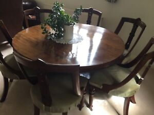 Antique round  Rosewood table in excellent condition and 6 mahogany chairs