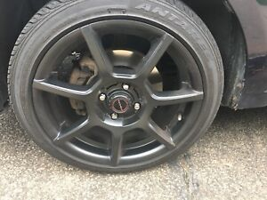 "16"" black aftermarket tires and rims"
