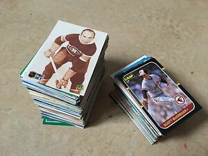 A collection of hockey and baseball cards from various years.