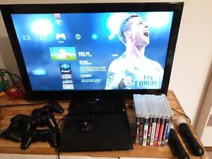 PlayStation 3 Slim, 4 controllers, 14 games