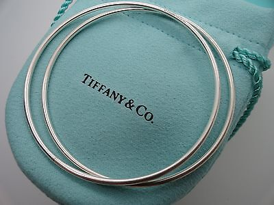 Tiffany & Co. Sterling Silver Pair of Round Thin Bangle Bracelets in Pouch & Box