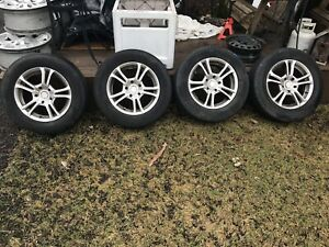 205/60r 16 Michelin defender tires mounted on alloy rims