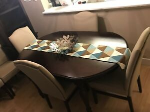 Chocolate brown dining table with 6 beige chairs
