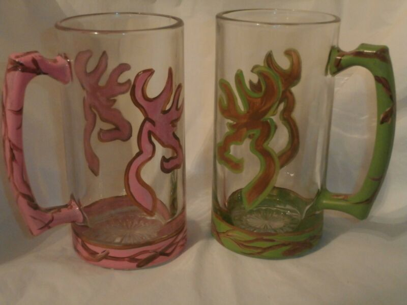 HAND PAINTED HIS AND HERS CAMO DEER BEER STEINS. SET OF 2 PINK AND GREEN.TREE