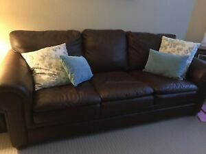 Brown leather couch and love seat