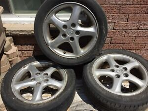 "Mazda 17"" rims with tires,"