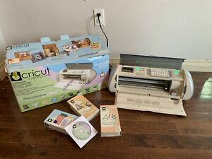 White cricut expression  with 3 cartridges included