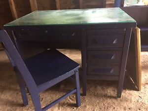 Navy blue antique desk with glass top