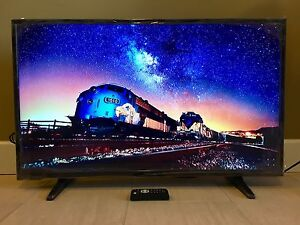 39 inch mint LED HD TV, remote, stand.