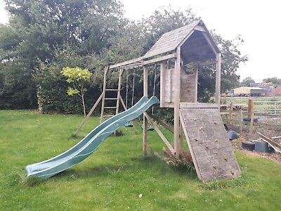 Dunster House wooden climbing frame, with swings, monkey bars and climbing wall
