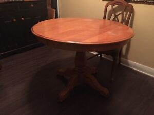 Wood pedestal table and chairs
