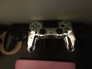 PS4 controller, 1 original, 1 chrome/green, 1 gripped & toggle London Ontario image 1