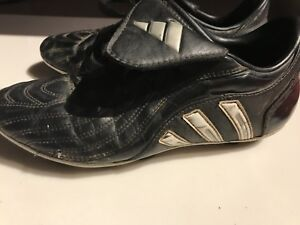 Adidas black and white soccer cleats size 5