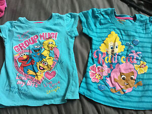 Sesame Street and bubble guppies shirts