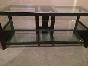 Glass table with TV stand bracket