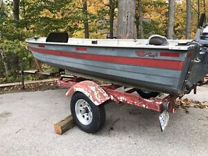 14 foot aluminum boat 9.9 HP Yamaha and trailer