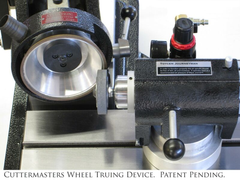 Braked Wheel Truing Device