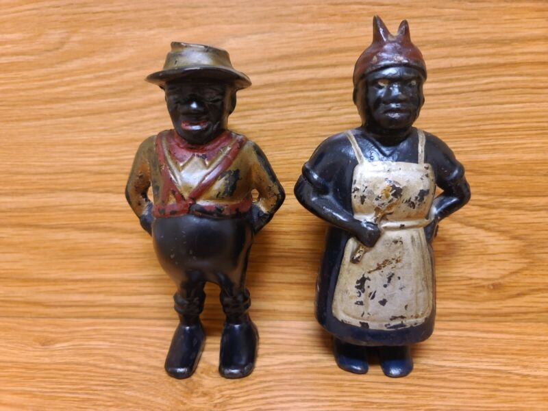 ANTIQUE A.C. WILLIAMS SHARECROPPER & MAMMY W/ SPOON CAST IRON BANKS