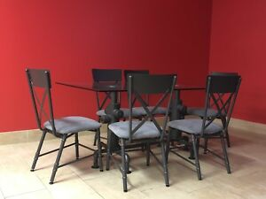 Barely used restaurant chairs and dining tables for sale