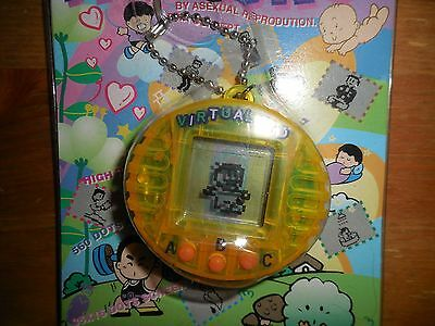 Vintage Virtual Kid Keychain Pocket Game Rare Yellow NIB Robber DR.