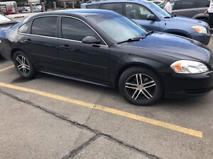 Black 2011 chevy Impala, remote starter, great traction