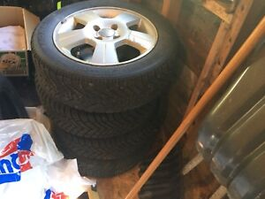 2007 Ford Focus aluminum rims and winter tires