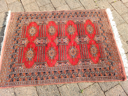 Signed small red wool Persian rug