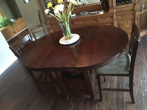 Solid wood bar height table and two chairs